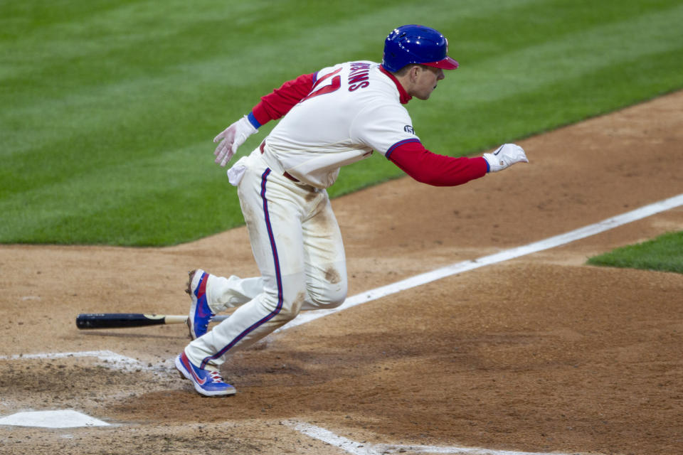 Philadelphia Phillies' Rhys Hoskins (17) runs to first on a single during the fifth inning of a baseball game against the St. Louis Cardinals, Saturday, April 17, 2021, in Philadelphia. (AP Photo/Laurence Kesterson)