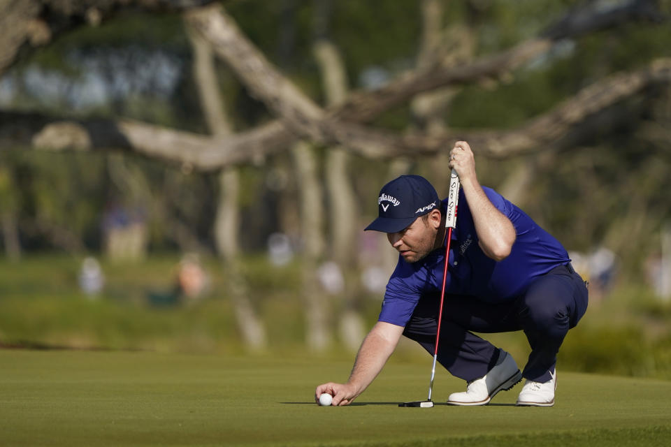 Branden Grace, of South Africa, lines up a putt on the third hole during the second round of the PGA Championship golf tournament on the Ocean Course Friday, May 21, 2021, in Kiawah Island, S.C. (AP Photo/Chris Carlson)