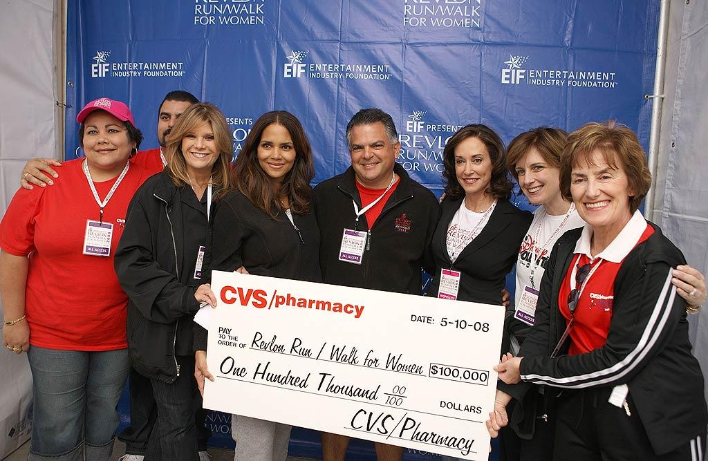 """Halle Berry helps CVS representatives present a check for $100,000 to the event co-founders Lily Paulsen (second from left) and Lilly Tartikoff (third from right). Chris Weeks/<a href=""""http://www.wireimage.com"""" target=""""new"""">WireImage.com</a> - May 10, 2008"""