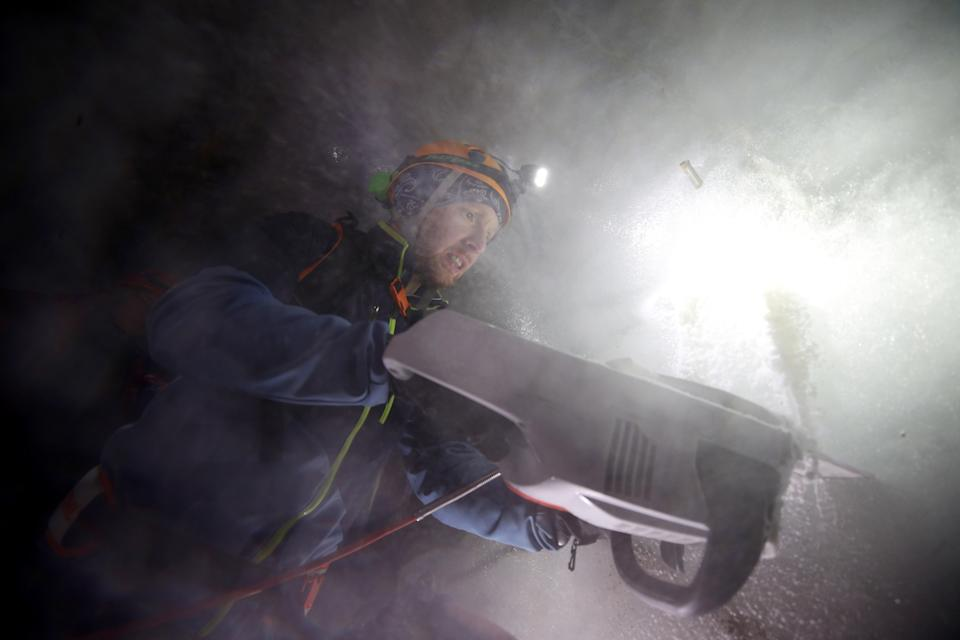 Environmental physicist Pascal Bohleber from the Austrian Institute for Interdisciplinary Mountain Research, uses a chainsaw to cut out a sample of ice inside an artificial ice tunnel of Schaufelferner glacier at Stubaier glacier ski resort near Neustift im Stubaital, Austria. (Photo: Lisi Niesner/Reuters)