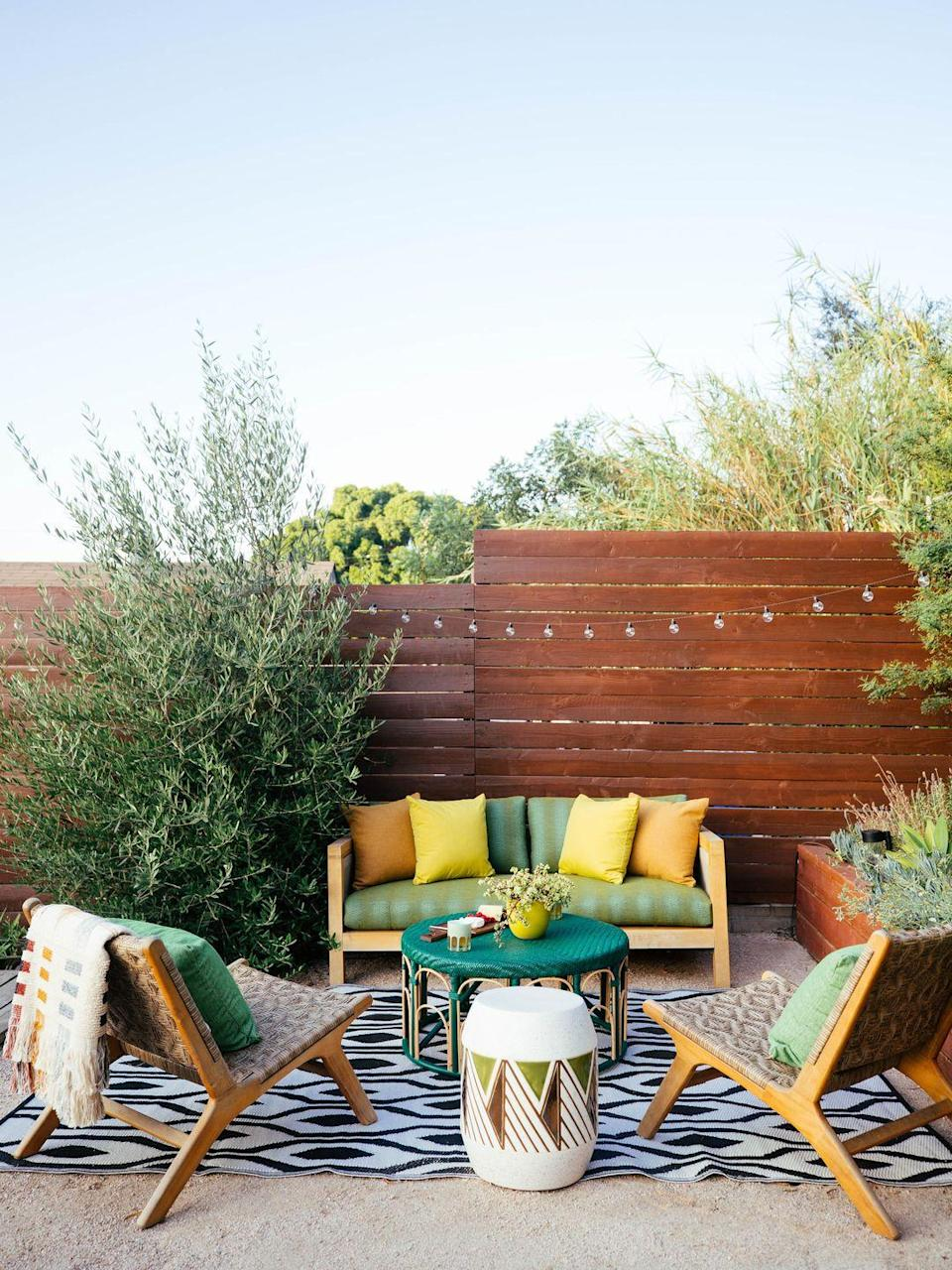 """<p>An easy way to make your outdoor space feel comfortable is to soften it with """"textured, durable and weather-friendly upholstery fabrics like <a href=""""https://urldefense.com/v3/__https:/nam11.safelinks.protection.outlook.com/?url=https*3A*2F*2Furldefense.com*2Fv3*2F__https*3A*2Fnam11.safelinks.protection.outlook.com*2F*3Furl*3Dhttps*3A*2F*2Furldefense.com*2Fv3*2F__https*3A*2Fnam11.safelinks.protection.outlook.com*2F*3Furl*3Dhttps*3A*2F*2Fwww.sunbrella.com*2Fsunbrella-upholstery-nurture-pebble-42102-0002*26data*3D04*7C01*7Csdooley*40glenraven.com*7Cd44ee0fe54144ef76ae308d8eaeb4bdf*7C6fd4b340533844999b1ebf247ab86d66*7C0*7C0*7C637517643612298247*7CUnknown*7CTWFpbGZsb3d8eyJWIjoiMC4wLjAwMDAiLCJQIjoiV2luMzIiLCJBTiI6Ik1haWwiLCJXVCI6Mn0*3D*7C1000*26sdata*3DrLOU9tDTmG8eeSefqbnal3E*2Fp*2BxrMdnC378ww5CbEWY*3D*26reserved*3D0__*3BJSUlJSUlJSUlJSUlJSUlJSUlJQ!!N96JrnIq8IfO5w!yBKFuBJEkKB0v5sDrOYUERENS1n85FwvoVceOjyDuksZqYXFBuZTT60DKjHVEdIT*24*26data*3D04*7C01*7CGVoorhis*40glenraven.com*7Ccf962d5af6bf4eb6830e08d8eafd14c4*7C6fd4b340533844999b1ebf247ab86d66*7C0*7C0*7C637517720024823980*7CUnknown*7CTWFpbGZsb3d8eyJWIjoiMC4wLjAwMDAiLCJQIjoiV2luMzIiLCJBTiI6Ik1haWwiLCJXVCI6Mn0*3D*7C1000*26sdata*3DA4Lro3bh5u*2BZ82iGrQEu1ammBQnBsuvtCW9bHltheoc*3D*26reserved*3D0__*3BJSUlJSUlJSUlJSoqKiolJSoqKioqKioqKioqKiUlKioqJSUlJSUlJSUlJSUlJSUlJSUl!!N96JrnIq8IfO5w!yOELrz0PR6jSEtUjEnnhlrgJmFsQSwt4JCugCbWHFTseTLvH7G8yg-FWMuCV1ayC*24&data=04*7C01*7Csdooley*40glenraven.com*7C9ee84b902c914ac4861d08d8eb162cb5*7C6fd4b340533844999b1ebf247ab86d66*7C0*7C0*7C637517827778088992*7CUnknown*7CTWFpbGZsb3d8eyJWIjoiMC4wLjAwMDAiLCJQIjoiV2luMzIiLCJBTiI6Ik1haWwiLCJXVCI6Mn0*3D*7C1000&sdata=DFc*2FAFN2SY7q*2FS4GiO6brrAM*2B77pRLaAV3PMPB14B0Q*3D&reserved=0__;JSUlJSUlJSUlJSoqKioqKioqKioqKioqKioqKioqKioqKioqKioqKioqKioqKiolJSoqKioqKioqKioqKiUlKiolJSUlJSUlJSUlJSUlJSUlJSUlJQ!!N96JrnIq8IfO5w!wQ_NwuWx640Es4uJ5O_aavPeXlccMgDwygVfJq6ZBPr1qkZMqHFbOkVqfTvW1CSOqyDW$"""" rel=""""nofollow noopener"""" target=""""_blank"""" data-ylk=""""slk:Nurture Pebble"""" class="""