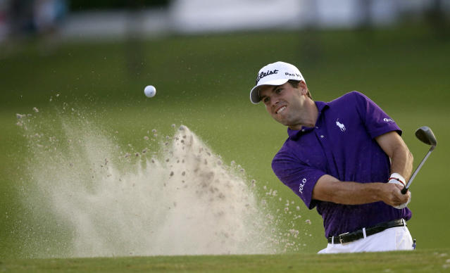 Ben Martin hits out of the sand onto the 18th green during the opening round of the PGA Zurich Classic golf tournament at TPC Louisiana in Avondale, La., Thursday, April 24, 2014. Martin treated a tiny gallery to a course-record round, shooting a 10-under 62 on Thursday. (AP Photo/Gerald Herbert)
