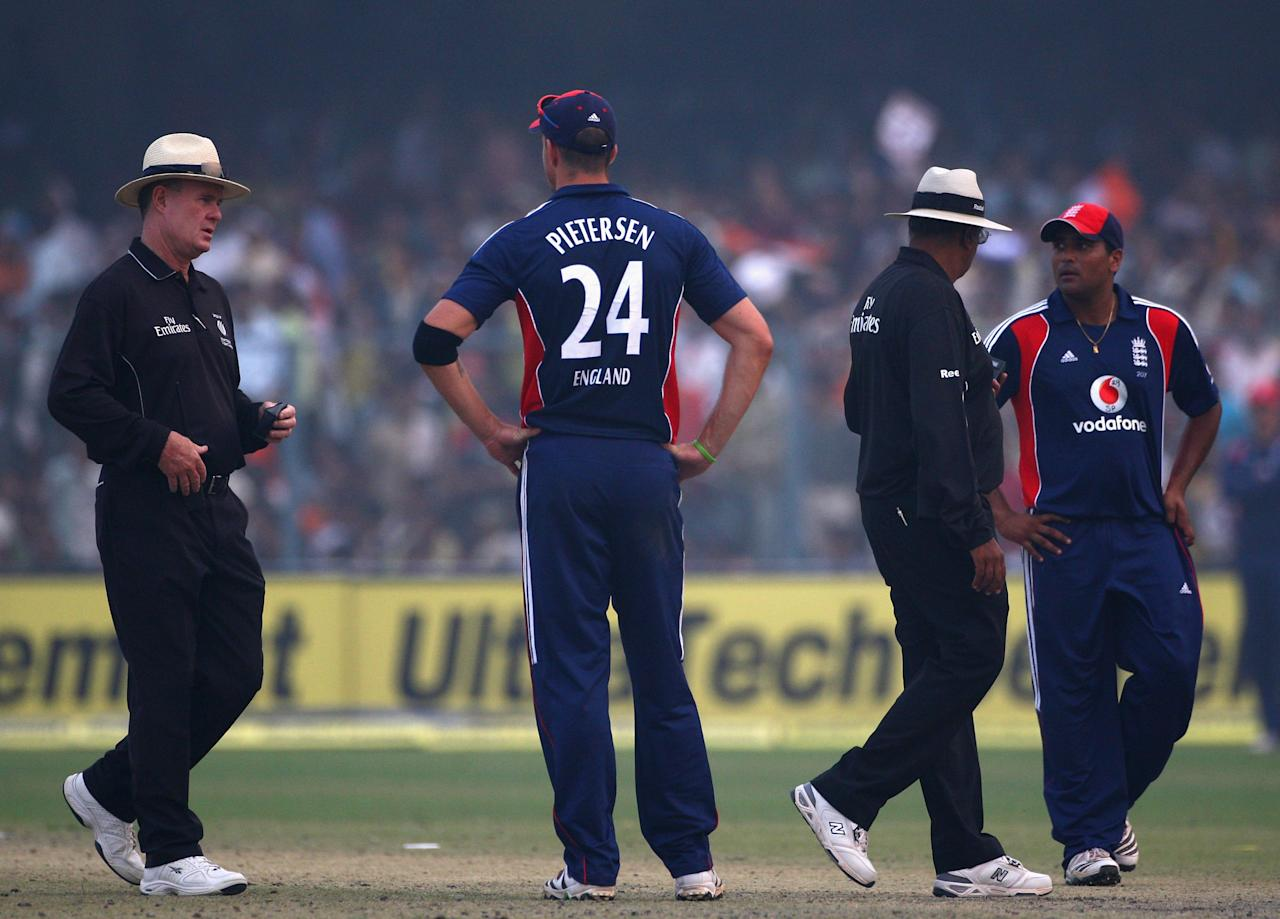 KANPUR, INDIA - NOVEMBER 20:  Umpires Russell Tiffin (l) and Amish Saheba (2ndR) with England players Kevin Pietersen (2nd left) and Samit Patel (r) after offering the light to the Indian batsmen and India were awarded victory under the Duckworth-Lewis rules in Kanpur to lead the one-day series 3-0 after bad light curtails play at the 3rd One Day International match between India and England at the Green Park Stadium on November 20, 2008 in Kanpur, India.  (Photo by Global Cricket Ventures/BCCI/Getty Images)