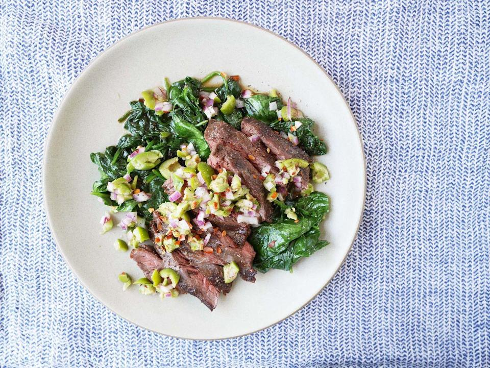 """<p>This veggie-centric take on steak will please both your inner carnivore and herbivore.</p><p>Get the recipe from <a href=""""https://www.delish.com/cooking/recipe-ideas/recipes/a42610/spiced-skirt-steaks-with/"""" rel=""""nofollow noopener"""" target=""""_blank"""" data-ylk=""""slk:Delish"""" class=""""link rapid-noclick-resp"""">Delish</a>.</p>"""