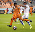 Houston Dynamo's Memo Rodriguez (8) advances toward the goal as Montreal Impact's Victor Cabrera (2) defends during the first half of an MLS soccer match Saturday, March 9, 2019, in Houston. (AP Photo/David J. Phillip)