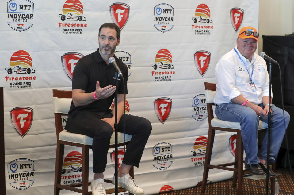 Jimmie Johnson, left, speaks about joining the team of Chip Ganassi, right, for the IndyCar series at a press conference during the IndyCar race weekend Saturday, Oct. 24, 2020, in St. Petersburg, Fla. (AP Photo/Mike Carlson)
