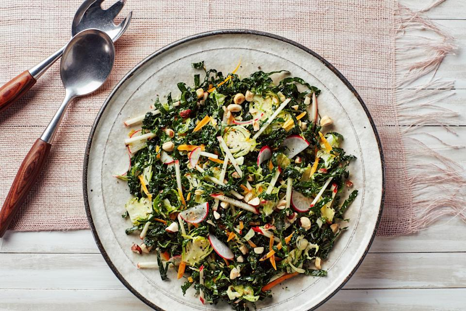 """French Mimolette cheese lends its rich, caramelized flavor to this crunchy salad while a jumble of textures (matchstick apples, sliced, radishes, shaved brussels sprouts) makes it fun to eat. <a href=""""https://www.epicurious.com/recipes/food/views/kale-salad-with-brussels-sprouts-apples-and-hazelnuts?mbid=synd_yahoo_rss"""" rel=""""nofollow noopener"""" target=""""_blank"""" data-ylk=""""slk:See recipe."""" class=""""link rapid-noclick-resp"""">See recipe.</a>"""