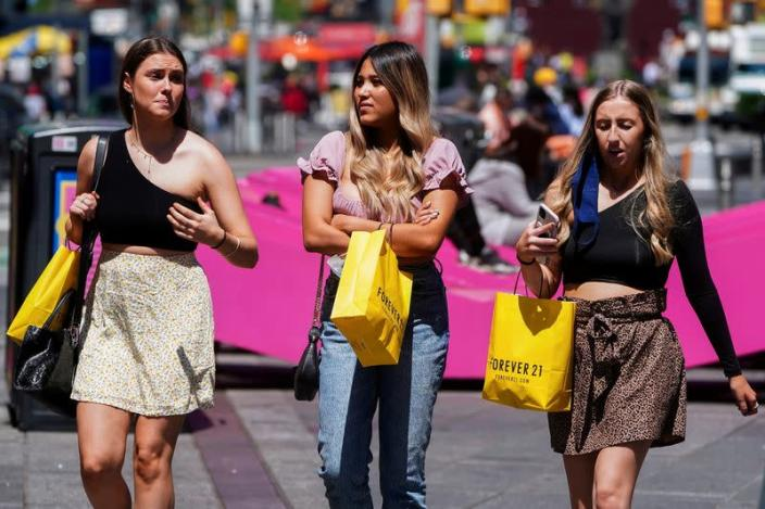 FILE PHOTO: People walk without protective masks in Times Square in New York City