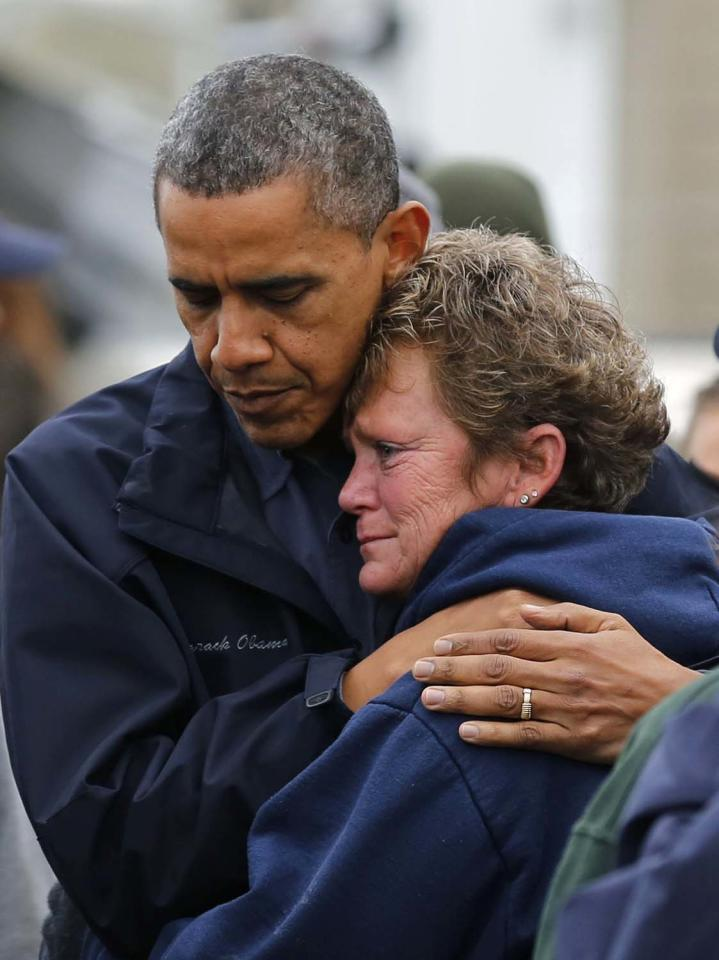 U.S. President Barack Obama hugs North Point Marina owner Donna Vanzant as he tours damage done by Hurricane Sandy in Brigantine, New Jersey, October 31, 2012. Putting aside partisan differences, Obama and Republican Governor Chris Christie toured storm-stricken parts of New Jersey together on Wednesday, taking in scenes of flooded roads and burning homes in the aftermath of superstorm Sandy.  REUTERS/Larry Downing