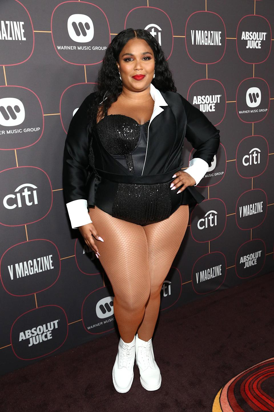 Lizzo proved once again that she is not afraid to take risks with her fashion choices when she turned up at the Warner Music Group Pre-Grammy Party in a black tuxedo leotard and all-white boots.