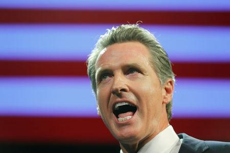 FILE PHOTO: California Democratic gubernatorial candidate Gavin Newsom speaks after  being elected governor of the state during an election  night party in Los Angeles, California, U.S. November 6, 2018.   REUTERS/Mike Blake/File Photo