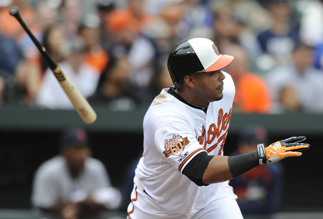 Baltimore Orioles' Nelson Cruz runs to first on a single against the Detroit Tigers in the fourth inning of a baseball game Wednesday, May 14, 2014, in Baltimore. (AP Photo/Gail Burton)