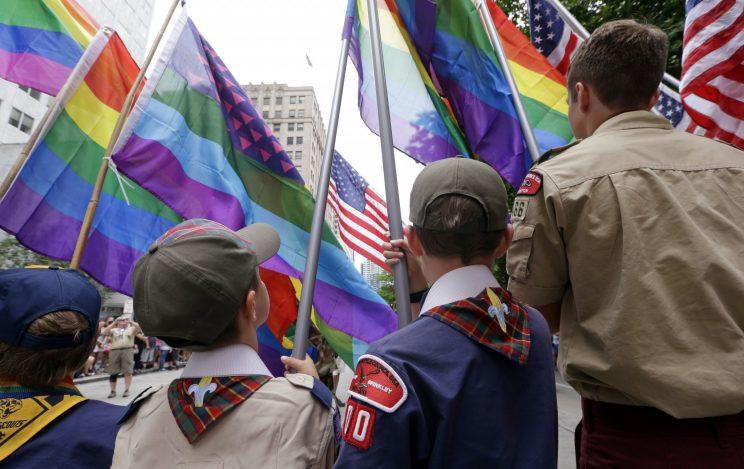 Cub Scouts and Boy Scouts prepare to lead marchers while waving rainbow-colored flags at the 41st annual Pride Parade in Seattle in June 2015, two days after the U.S. Supreme Court legalized gay marriage nationwide. (Photo: Elaine Thompson/AP)