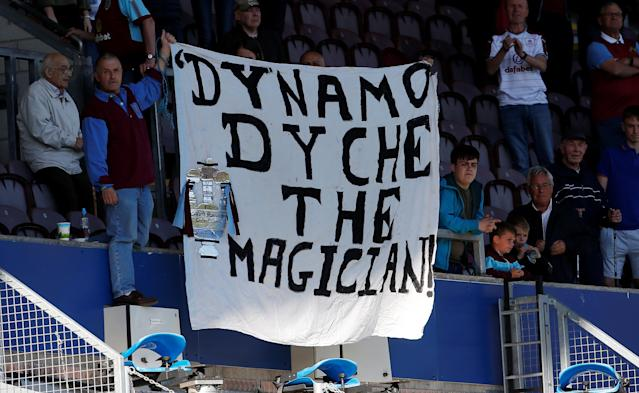 "Soccer Football - Premier League - Burnley vs AFC Bournemouth - Turf Moor, Burnley, Britain - May 13, 2018 Burnley fans display a banner referring to manager Sean Dyche after the match Action Images via Reuters/Craig Brough EDITORIAL USE ONLY. No use with unauthorized audio, video, data, fixture lists, club/league logos or ""live"" services. Online in-match use limited to 75 images, no video emulation. No use in betting, games or single club/league/player publications. Please contact your account representative for further details."