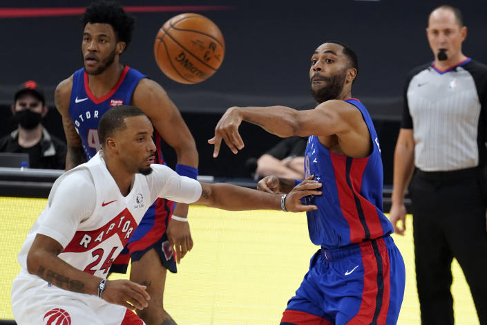 Detroit Pistons guard Wayne Ellington (8) passes the ball over Toronto Raptors guard Norman Powell (24) during the second half of an NBA basketball game Wednesday, March 3, 2021, in Tampa, Fla. (AP Photo/Chris O'Meara)