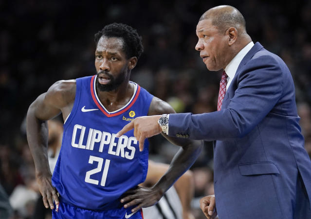 Los Angeles Clippers head coach Doc Rivers, right, talks to Clippers guard Patrick Beverley during the first half of an NBA basketball game against the San Antonio Spurs, Saturday, Dec. 21, 2019, in San Antonio. (AP Photo/Darren Abate)