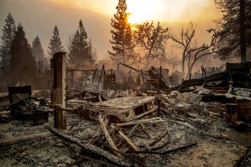 This Nov. 8, 2018, file photo shows a vintage car among debris after the Camp Fire tears through Paradise, Calif. California officials said Tuesday, Nov. 19, 2019, that crews have finished removing millions of tons of debris left by a Northern California wildfire that killed 85 people and virtually annihilated a town. The Camp Fire was the deadliest and most destructive wildfire in state history.