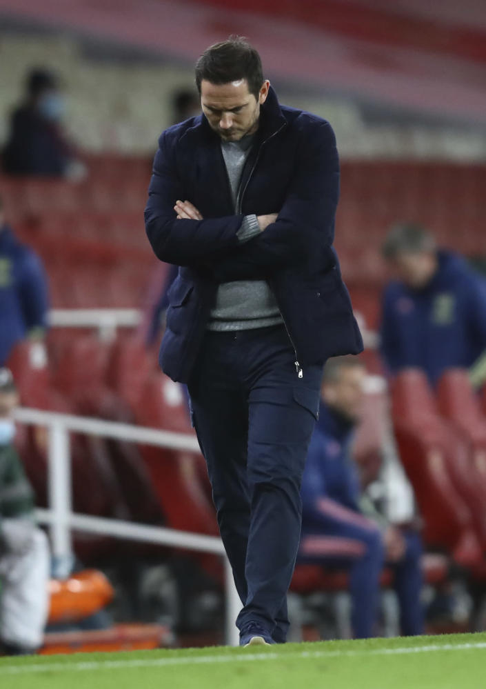 Chelsea's head coach Frank Lampard looks down as he walks on the side lines during their English Premier League soccer match between Arsenal and Chelsea at the Emirates stadium in London, Saturday, Dec. 26, 2020. (Julian Finney Pool via AP)