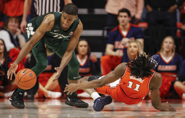 "Illinois' <a class=""link rapid-noclick-resp"" href=""/ncaab/players/147262/"" data-ylk=""slk:Ayo Dosunmu"">Ayo Dosunmu</a> slips and is injured on the final play of the game sealing the win for Michigan State on Tuesday night in Champaign, Illinois. (Michael Hickey/Getty Images)"