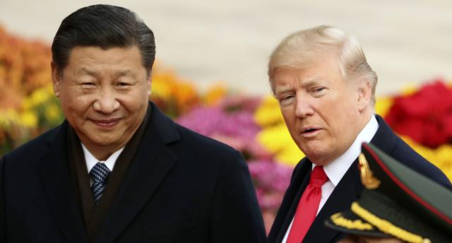 Trade warriors? President Trump with Chinese President Xi Jinping in Beijing last year. (AP Photo/Andrew Harnik)