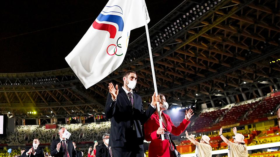 Flag bearers Sofya Velikaya and Maxim Mikhaylov of Team ROC lead their team in during the Opening Ceremony of the Tokyo 2020 Olympic Games.