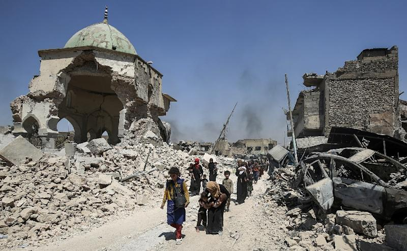 Mosul's Old City has been reduced to rubble by fighting and the iconic leaning minaret of its Al-Nuri mosque left in ruins (AFP Photo/AHMAD AL-RUBAYE)