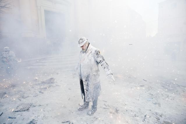 IBI, SPAIN - DECEMBER 28: A Reveller takes part in the battle of 'Enfarinats', a flour fight in celebration of the Els Enfarinats festival on December 28, 2012 in Ibi, Spain. Citizens of Ibi annually celebrate the festival with a battle using flour, eggs and firecrackers. The battle takes place between two groups, a group of married men called 'Els Enfarinats' which take the control of the village for one day pronouncing a whole of ridiculous laws and fining the citizens that infringe them and a group called 'La Oposicio' which try to restore order. At the end of the day the money collected from the fines is donated to charitable causes in the village. The festival has been celebrated since 1981 after the town of Ibi recovered the tradition but the origins remain unknown. (Photo by David Ramos/Getty Images)