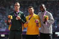 (left-right) Silver medalist South Africa's Oscar Pistorius, Gold medalist Brazil's Alan Fonteles Cardoso Oliveira and Bronze medalist USA's Blake Leeper celebrate with their medals after competing in the Men's 200m - T44 at the Olympic Stadium, London.