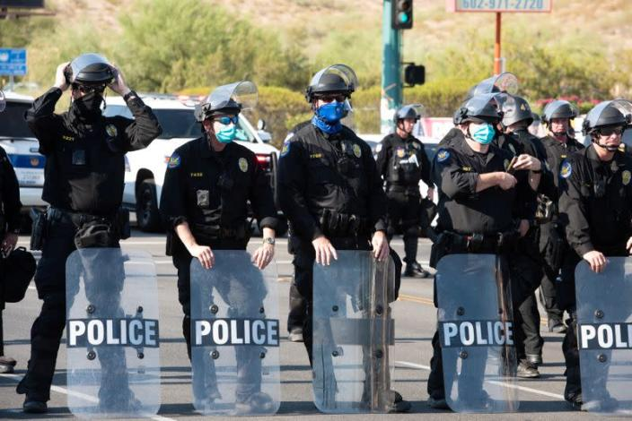 Police block protesters during a visit by U.S, President Donald Trump to the Dream City Church in Phoenix