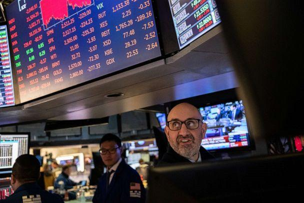 PHOTO: Traders work on the floor of the New York Stock Exchange on March 12, 2020, in New York. (Jeenah Moon/Getty Images)