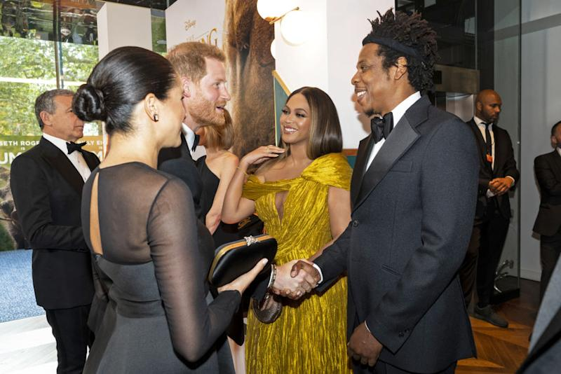 "Prince Harry, Duke of Sussex (3rd L) and Meghan, Duchess of Sussex (2nd L) meet cast and crew, including Beyonce Knowles-Carter (C) Jay-Z (R) as they attend the European Premiere of Disney's ""The Lion King"" at Odeon Luxe Leicester Square on July 14, 2019 in London, England. (Photo by Niklas Halle'n-WPA Pool/Getty Images)"