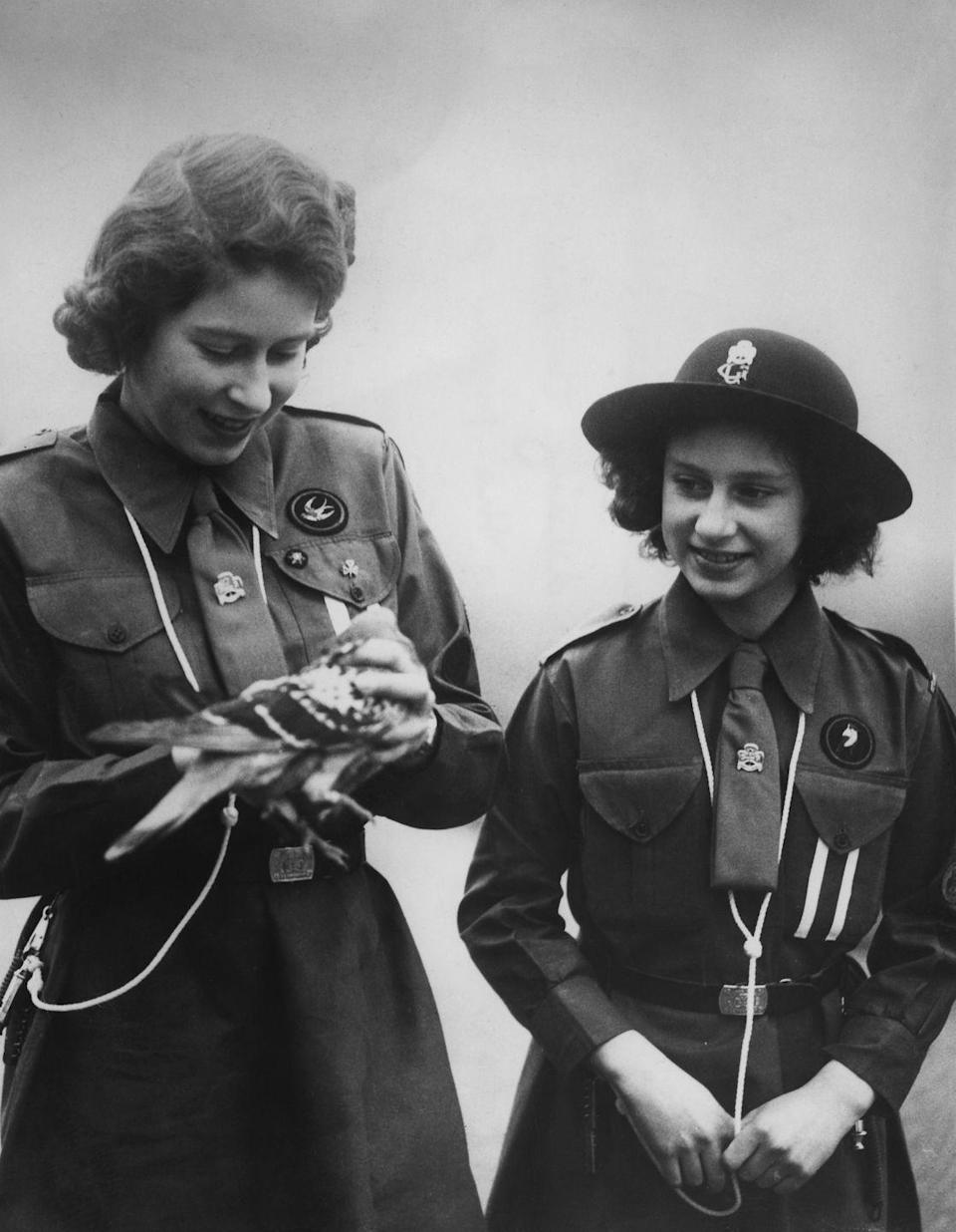 <p>Princess Elizabeth with her younger sister, Princess Margaret Rose, holding a pigeon.</p>