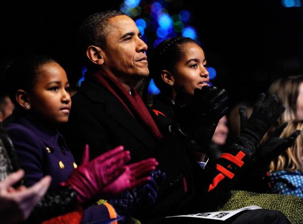 U.S. President Barack Obama and daughters Sasha (L) and Malia participate in the 2011 National Christmas Tree Lighting on December 1, 2011 at the Ellipse, south of the White House, in Washington, DC. The first family participated in the 89th annual National Christmas Tree Lighting Ceremony. (Photo by Roger L. Wollenberg-Pool/Getty Images)