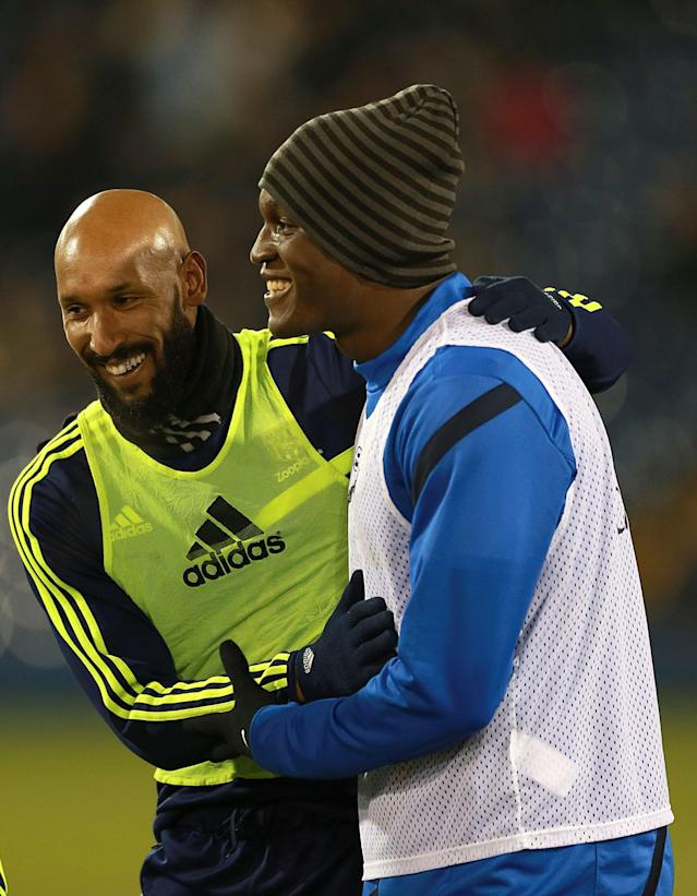Everton's Romelu Lukaku, right, and West Bromwich Albion's Nicolas Anelka embrace while warming up during the English Premier League soccer match between West Bromwich Albion and Everton at The Hawthorns, West Bromwich, England, Monday. Jan. 20, 2014. (AP Photo/PA, David Davies)