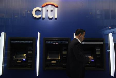 A man walks past a Citibank branch in lower Manhattan, New York