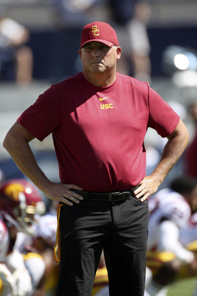 Southern California head coach Clay Helton watches his players warm up before a NCAA college football game against BYU, Saturday, Sept. 14, 2019, in Provo, Utah. (AP Photo/George Frey)