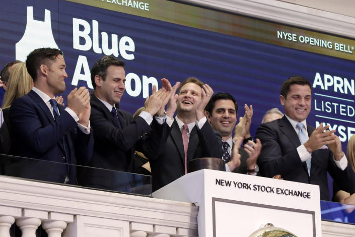Blue Apron CEO Matt Salzberg, center, joins applause with fellow company co-founders Matt Wadiak, second left, and Ilia Papas, second from right, during opening bell ceremonies of the New York Stock Exchange before their IPO begins trading, Thursday, June 29, 2017. NYSE President Tom Farley is at right. (AP Photo/Richard Drew)