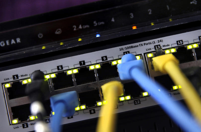 FILE - In this June 19, 2018, file photo, a router and internet switch are displayed in East Derry, N.H. The FBI said cyberattacks have become common at schools, which are attractive targets because they hold sensitive data and provide critical public services. Malicious use of the data could lead to bullying, tracking and identity theft, the agency said. (AP Photo/Charles Krupa, File)