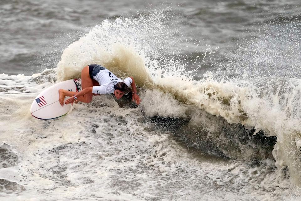 Caroline Marks maneuvers on a wave during the quarterfinals of the women's surfing competition.