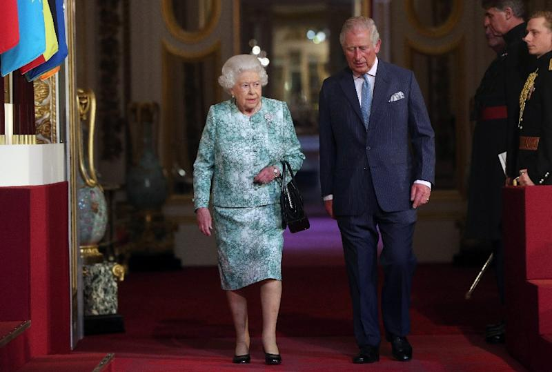 Queen Elizabeth II and Prince Charles arrive for the formal opening of the Commonwealth Heads of Government Meeting in Buckingham Palace