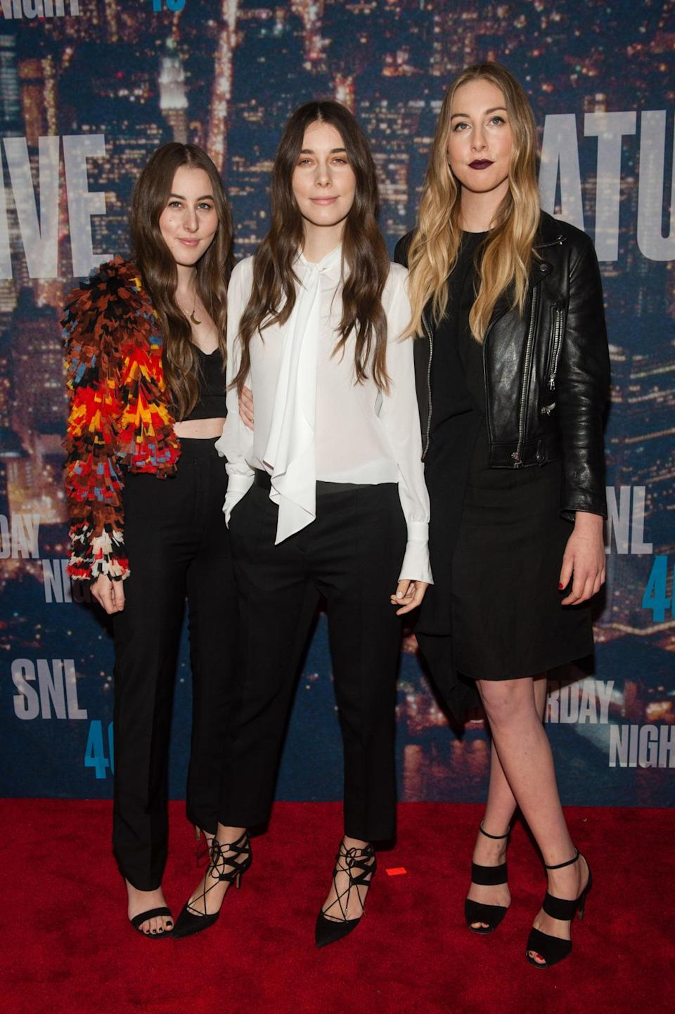 Fresh off stunning on the red carpet at the Grammy Awards, Haim is back with more fashion-forward outfits. The band performed at the anniversary show's after-party and were most likely on hand at the actual event to support their shared BFF Taylor Swift.