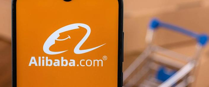 Alibaba logo on the screen smartphone. Alibaba Group Holding Limited is a Chinese multinational technology company specializing in e-commerce, retail, Internet.