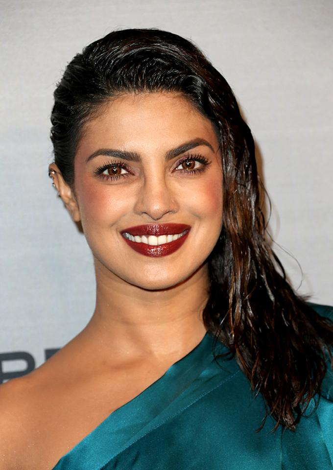 """<p><a rel=""""nofollow"""" href=""""http://www.sephora.com/madam-cj-walker-beauty-culture?node=1710116&icid2=madam_lp_spotlight_image"""" rel=""""nofollow"""">Priyanka Chopra rounds out our list of wet hair looks we love with this shiny style she wore to the <em>InStyle</em> Awards. Playing off her jewel green top, celebrity makeup artist Pati Dubroff painted the actress' face with rosy shades. <em>To get Chopra's exact lip color, try </em></a><em><a rel=""""nofollow"""" href=""""http://www.lauramercier.com/lipstick/velour-lovers-lip-colour-prod12615519.html#q=velour&start=3"""" rel=""""nofollow"""">Laura Mercier Velour Lovers Lip Colour in Voyeur</a></em><a rel=""""nofollow"""" href=""""http://www.lauramercier.com/lipstick/velour-lovers-lip-colour-prod12615519.html#q=velour&start=3"""" rel=""""nofollow"""">, $28. (Photo: Frederick M. Brown/Getty Images) </a></p>"""
