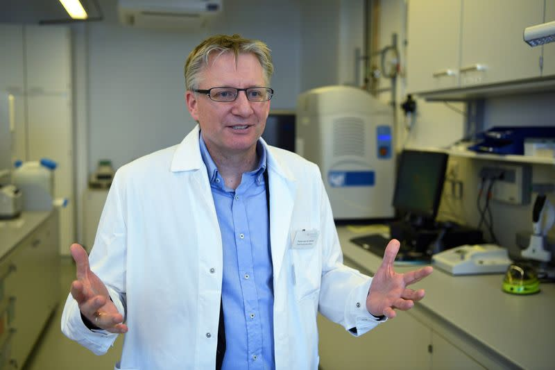 FILE PHOTO: Florian von der Muelbe, COO of German biopharmaceutical company CureVac, explains the company's research on a vaccine for the coronavirus (COVID-19) disease at a laboratory in Tuebingen