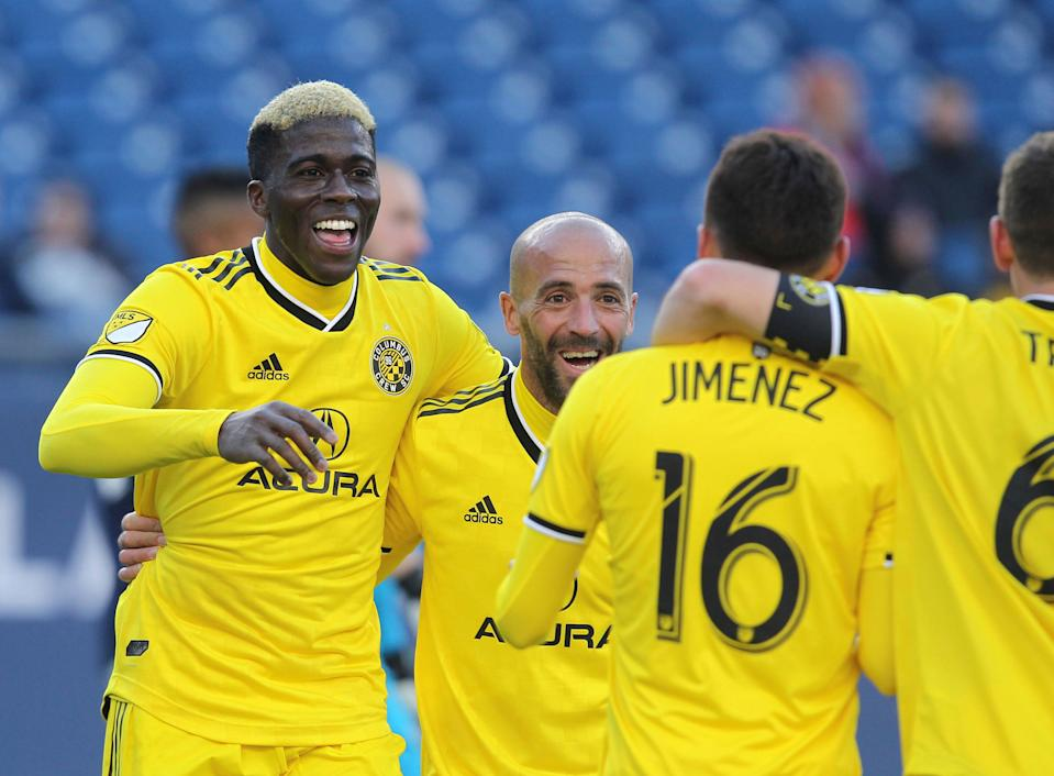 Columbus Crew's Gyasi Zardes, left, celebrates his second goal of the game with his team during the second half of an MLS soccer game against the New England Revolution, Saturday, March 9, 2019, in Foxborough, Mass. (AP Photo/Stew Milne)