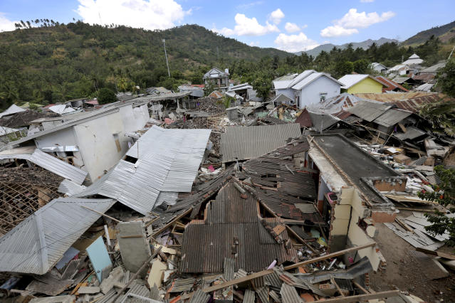 <p>Houses damaged by an earthquake are seen in North Lombok, Indonesia, Tuesday, Aug. 7, 2018. (Photo: Tatan Syuflana/AP) </p>