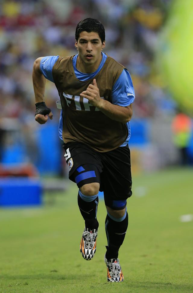 Uruguay's Luis Suarez warms up on the touch line during the group D World Cup soccer match between Uruguay and Costa Rica at the Arena Castelao in Fortaleza, Brazil, Saturday, June 14, 2014. (AP Photo/Bernat Armangue)