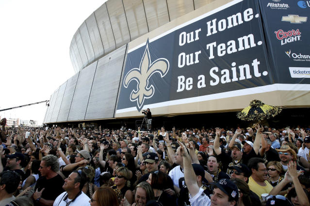 FILE - In this Sept. 25, 2006, file photo, New Orleans Saints fans listen to the Goo Goo Dolls in front of the Louisiana Superdome in New Orleans before an NFL game between the Saints and the Atlanta Falcons. (AP Photo/Alex Brandon, File)