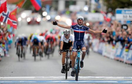 Benoit Cosnefroy (R) from France finishes first and Lennard Kamna (L) from Germany second in UCI Cycling Road World Championships Men Under 23 in Bergen, Norway September 22, 2017. NTB Scanpix/Cornelius Poppe via REUTERS