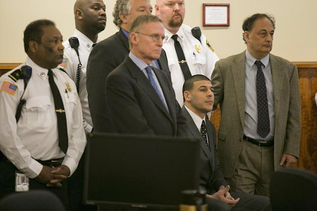 Former NFL player Aaron Hernandez and his defense team listen as the guilty verdict is read during his murder trial at the Bristol County Superior Court in Fall River, Massachusetts, April 15, 2015. Hernandez, 25, a former tight end for the New England Patriots, is convicted of fatally shooting semiprofessional football player Odin Lloyd in an industrial park near Hernandez's Massachusetts home in June 2013. REUTERS/Dominick Reuter